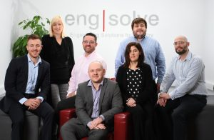 engsolve's engineering consultants in a team photo in a brightly lit board room
