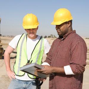 Engineering consultants on site discussing a project