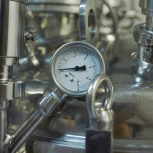 a pressure gage on a silver gas canister