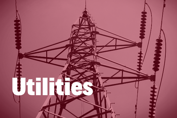 utilities in white and bold text hovering over an image of a electric pylon