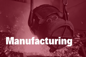 Manufacturing in white bold text hovering over a in image of a steel manufacturing plant with sparks flying around