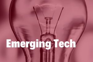 Emerging tech in white bold text hovering over a close up image of a traditional light bulb