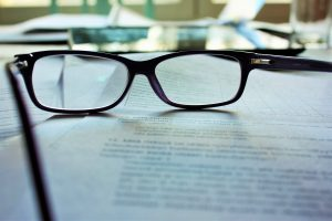 Pair of glasses on a written contract